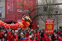 Marchers from the Canadian Broadcasting Company (CBC) carry a balloon Dragon in the 41st annual Chinese New Year Parade in Chinatown, Vancouver, BC, Canada. The 2014 celebrations mark the beginning of the Year of the Horse in the traditional Chinese lunar calendar.