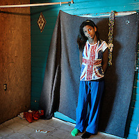 Dyjona Lee pictured in her room. She and her family live on Isle Jean Charles, a predominantly Native American community on the coast in southeast Louisiana. The island is particularly affected by coastal erosion. Residents are seeking higher ground and only 70 residents remain of the 300 residents at the peak of population.
