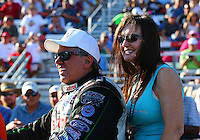 Sep 14, 2013; Charlotte, NC, USA; NHRA funny car driver John Force (left) with wife Laurie Force during qualifying for the Carolina Nationals at zMax Dragway. Mandatory Credit: Mark J. Rebilas-