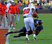 Oct. 22, 2011 - Charlottesville, Virginia - USA; Virginia Cavaliers cornerback Chase Minnifield (13) tackles North Carolina State Wolfpack wide receiver Bryan Underwood (80) during an NCAA football game at the Scott Stadium. NC State defeated Virginia 28-14. (Credit Image: © Andrew Shurtleff
