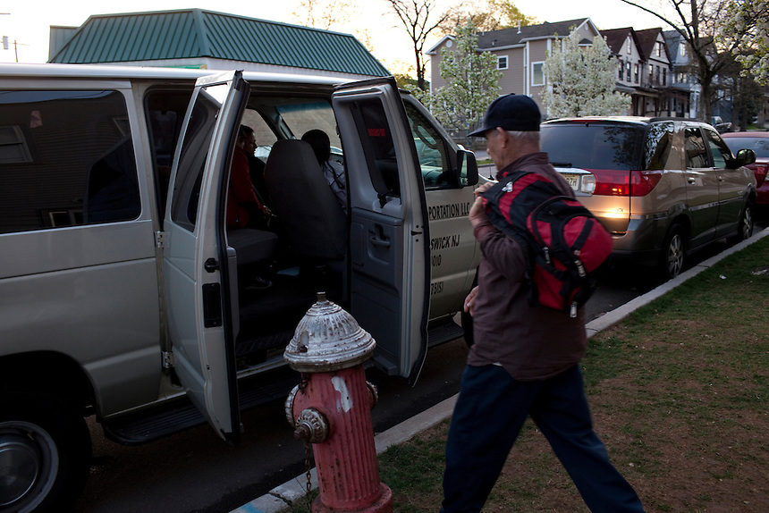 Temp workers board vans outside Brickforce Staffing on French Street to take them to warehouses in New Brunswick, NJ on April 18, 2013. Across America, temp work has become a mainstay of the blue-collar economy, leading to the proliferation of ?temp towns? ? places where it's difficult to find work except through a temp agency and where workers suffer wage theft, no benefits and high injury rates, all for jobs that may end tomorrow for any reason.
