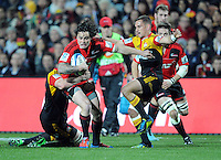 Crusaders Zac Guildford, left, fends off the Chiefs Aaron Cruden in the Super 15 Rugby semi final match, Waikato Stadium, New Zealand, Friday, July 27, 2012. Credit:SNPA / Ross Setford