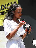 NEW YORK, NY - JUNE 22:   Kelly Rowland eats Breyers ice cream at the Breyers Ice Cream 150th Birthday Blowout celebration in Madison Square Park in New York, New York on June 22, 2016.  Photo Credit: Rainmaker Photo/MediaPunch
