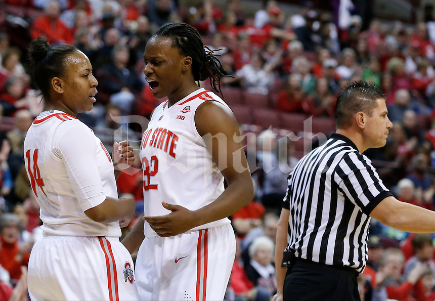 Ohio State Buckeyes forward Shayla Cooper (32) yells as teammate Ohio State Buckeyes guard Ameryst Alston (14) draws a foul during Thursday's NCAA Division I women's basketball game against the Rutgers Scarlet Knights at Value City Arena in Columbus on January 1, 2015. Ohio State led at the half, 40-27. (Dispatch Photo by Barbara J. Perenic)
