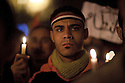 Egyptian protesters march with candles during a February 09, 2011 candlelight vigil for victims of the 2 week long Egyptian uprising against the Hosni Mubarak regime in Tahrir Square in downtown Cairo, Egypt. Human Rights groups claim close to 300 people have lost their lives so far during the unprecedented and widespread protests across Egypt that threaten to topple the nearly 30 year old regime of Mubarak. . (Photo by Scott Nelson).