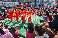 Dance performance on Eighth Avenue in the Sunset Park neighborhood in Brooklyn in New York on Sunday, February 28, 2016 during the Lantern Festival street fair. Sunset Park has become Brooklyn's Chinatown as Chinese and other Asian groups have moved there and businesses have sprouted up to cater to them. (© Richard B. Levine)