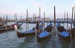 Gondolas moored in Venice, Italy.