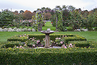 Formal garden with bird bath and arbor