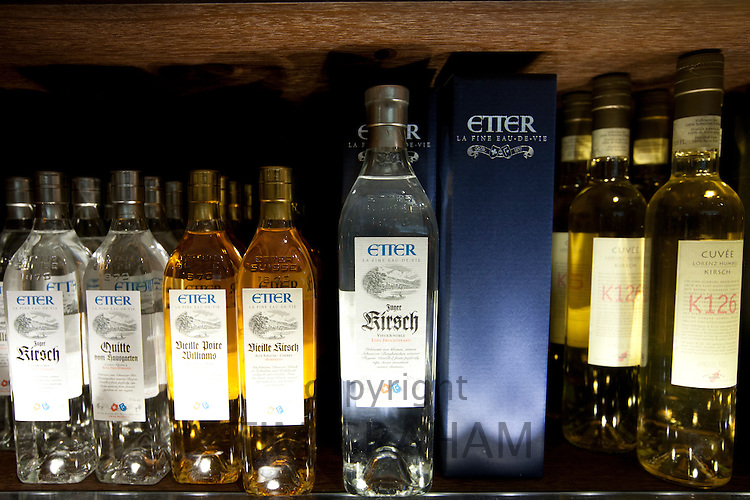Liquor, Etter Eau de Vie and Kirsch on display at Dalmayr food shop and delicatessen in Munich, Bavaria, Germany
