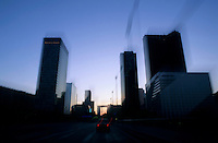 Skyscrapers of La Défense seen from a moving vehicle, Paris, France.