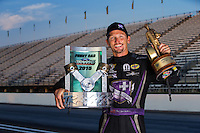 Sep 7, 2015; Clermont, IN, USA; NHRA funny car driver Jack Beckman poses for a portrait as he celebrates after winning the US Nationals at Lucas Oil Raceway. Mandatory Credit: Mark J. Rebilas-USA TODAY Sports