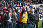 Crystal Palace supporters celebrating on the pitch at Hillsborough after the final whistle of the crucial last-day relegation match against Sheffield Wednesday. The match ended in a 2-2 draw which meant Wednesday were relegated to League 1. Crystal Palace remained in the Championship despite having been deducted 10 points for entering administration during the season.
