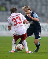 Fussball 2. Bundesliga:  Saison   2012/2013,    14. Spieltag  TSV 1860 Muenchen - 1. FC Koeln  16.11.2012 Matthias Lehmann (li, 1. FC Koeln) gegen Daniel Halfar (1860 Muenchen)