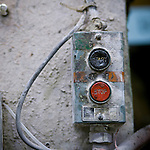 A dusty start and stop switch at a factory in Drummondville, Quebec, Canada.
