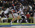 Ole Miss quarterback Bo Wallace (14) scores on a 14 yard run as Texas A&amp;M defensive back Deshazor Everett (29) and Texas A&amp;M defensive back Tramain Jacobs (7) chase in Oxford, Miss. on Saturday, October 6, 2012. Texas A&amp;M won 30-27...