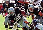 Oakland Raiders vs. Denver Broncos at Oakland Alameda County Coliseum Sunday, September 20, 1998.  Broncos beat Raiders  34-17.  Oakland Raiders running back Napoleon Kaufman (26).