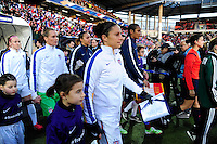 Lorient, France. - Sunday, February 8, 2015: Carli Lloyd (10) of the USWNT and Wendie Renard (2) of France lead the teams out. USWNT vs France during an international friendly at the Stade du Moustoir.
