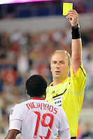 Referee Silviu Petrescu issues a yellow card to Dane Richards (19) of the New York Red Bulls. The New York Red Bulls defeated the San Jose Earthquakes 2-0 during a Major League Soccer (MLS) match at Red Bull Arena in Harrison, NJ, on August 28, 2010.