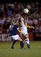 Caroline Miller (10) of Virginia stays close to Cory Ryan (4) of Maryland as she takes control of the ball during the game in College Park, MD.  Maryland defeated Virginia, 3-1.