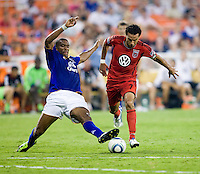 Dwayne De Rosario (7) of D.C. United steps out of the tackle of Sylvain Distin (15) of Everton during their friendly match held at RFK Stadium in Washington, DC.  D.C. United lost to Everton, 3-1.