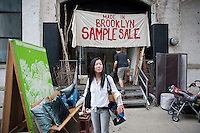 Visitors to the Dumbo Arts Festival in Brooklyn in New York on Saturday, September 24, 2011 visit a Made in Brooklyn Sample Sale featuring merchandise produced locally.  (© Richard B. Levine)