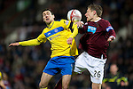 Hearts v St Johnstone...03.12.11   SPL .Carl Finnigan and Marius Zaliukas.Picture by Graeme Hart..Copyright Perthshire Picture Agency.Tel: 01738 623350  Mobile: 07990 594431