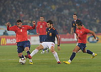 Second-half substitute Cesc Fabregas and Chile's Mauricio Isla compete for a loose ball. Spain won Group H following a 2-1 defeat of Chile in Pretoria's Loftus Versfeld Stadium, Friday, June 25th, at the 2010 FIFA World Cup in South Africa..