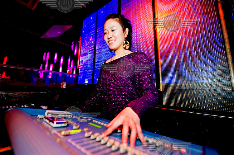 A DJ stands at her decks at Vics nightclub.