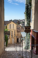 Cobbled street in traditional town of St Emilion, in the Bordeaux wine region of France