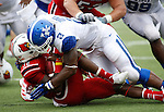 UK sophomore linebacker Alvin Dupree tackles UL junior runningback Senorise Perry during the second half of the UK vs. UL football game at Papa John's Cardinal Stadium in Louisville, Ky., on Sunday, September 2, 2012. Photo by Tessa Lighty | Staff