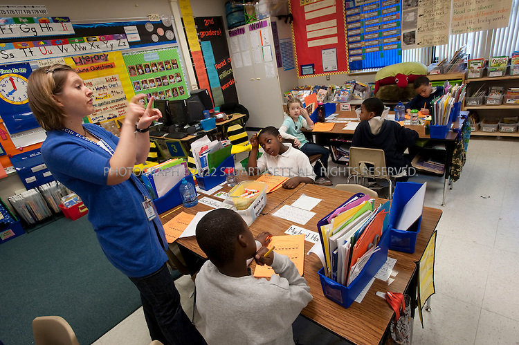 3/26/2010--Seattle, WA, USA.Heidi Trudel leads her 2nd grade students in class at the Leschi Elementary School in Seattle. When the Seattle Public School system closed schools in the nearby Central District in 2009, including TT Minor Elementary school, many of the children were transferred to Leschi...©2010 Stuart Isett. All rights reserved.