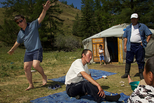 Herders feast and get drunk in front of their yurt in the taiga in Tuva Republic, Russia to celebrate Orlan's (in whte shirt) 35th birthday. Orlan (Tuvans normally use just one name) owns about 50 sheep, goats and milking cows. Like many other animal herders in the republic, Orlan prefers traditional farming methods but finds it difficult to compete in modern society.