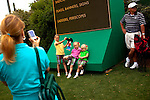 Sisters Kaleigh, 8, Peyton, 5, and Jessica Phillips, 4, pose for a photo with Flat Stanley, a paper character from a book, for their mother Kristin outside of Gate 6 of the Augusta National Golf Club on the first tournament day of The Masters Golf Tournament in Augusta, Georgia April 8, 2010. The sisters enjoy M&Ms and ice cream while their parents Jeff and Kristin, of Fairhope, Alabama, enjoy the golf.