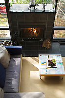 The open plan living area is heated by a fuel efficient wood-burning stove