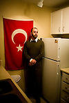 "Former Army Specialist and Guantanamo guard Terry ""TJ"" Holdbrooks poses for portraits in his Scottsdale apartment and the mosque that he attends in the greater Phoenix area.  Since leaving the US Army, Holdbrooks has been a critic of the facility since leaving the Army in 2005 and credits his experience at the facility for his conversion to Islam.  During his tour as a guard, Holdbrooks received a Koran from Chaplan James L. Yee  as well as a traditional prayer rug from one of the inmates.  (Yee is Army Captain accused of spying during his tenure at Guantanamo; the charges were dismissed)"