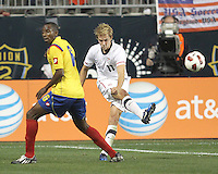 Stuart Holden #11 of the USA MNT boots the ball past Juan David Valencia #6 of Colombia during an international friendly match at PPL Park, on October 12 2010 in Chester, PA. The game ended in a 0-0 tie.