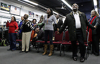 People attend a tribute service for Nelson Mandela at the National Action Network's headquarters in the Harlem with New York City Mayor-elect Bill de Blasio in New York December 07, 2013, Photo by Kena Betancur / VIEWpress.
