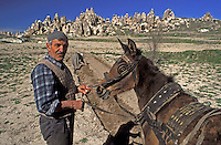 Goreme, Cappadocia, Nevsehir, Turkey. A farmer plows the land with a horse drawn plough. Although toursim is upcoming, many people still live of their traditional livelyhood. they work the fields in the fairy chimney landscape of Cappadocia and the Goreme National Park. Photo by Frits Meyst / MeystPhoto.com