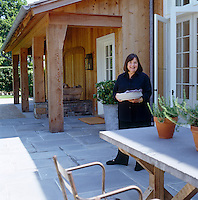 Ina Garten is making preparations for lunch on her secluded East Hampton terrace