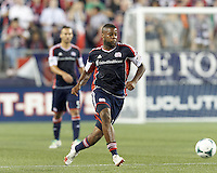 New England Revolution defender Andrew Farrell (2) brings the ball forward.  In a Major League Soccer (MLS) match, the New England Revolution (blue) defeated Chicago Fire (red), 2-0, at Gillette Stadium on August 17, 2013.