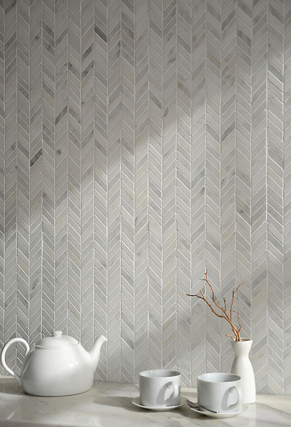 Chevron, a handmade mosaic shown in polished Calacatta Radiance, is part of The Studio Line of Ready to Ship mosaics.