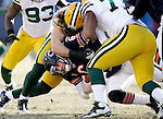 .Green Bay Packers' Clay Matthews and Cullen Jenkins sack Chicago Bears' Jay Cutler for a loss in the 1st quarter. .The Green Bay Packers traveled to Soldier Field in Chicago to play the Chicago Bears in the NFC Championship Sunday January 23, 2011. Steve Apps-State Journal.