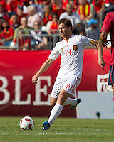 Spain midfielder Xabi Alonso (14) passes the ball. In a friendly match, Spain defeated USA, 4-0, at Gillette Stadium on June 4, 2011.