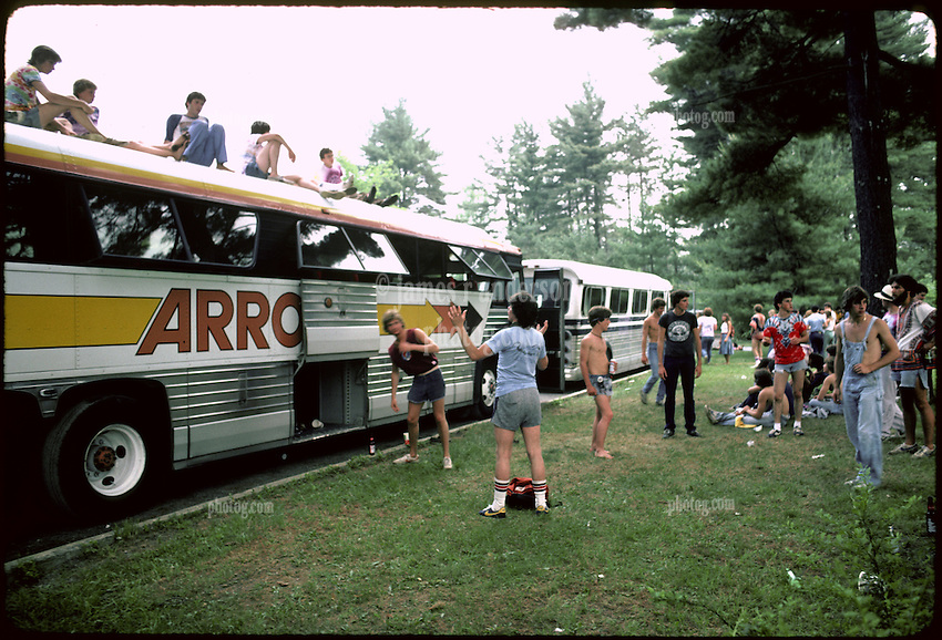 Deadheads came in by bus and hanging out in the parking lot, Saratoga Performing Arts Center. 18 June 1983 SPAC. Kodachrome film original image.