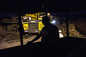 BCCL employees wait to go for the night shift at the Goladi open cast mining site in Jharia, outside of Dhanbad in Jharkhand, India.  Photo: Sanjit Das/Panos