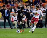 Clyde Simms (19) of D.C. United fights for the ball with Dwayne De Rosario (11) of the New York Red Bulls during the game at RFK Stadium in Washington, DC.  D.C. United lost to the New York Red Bulls, 4-0.