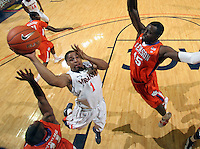 Feb. 2, 2011; Charlottesville, VA, USA; Virginia Cavaliers guard Jontel Evans (1) shoots between Clemson Tigers guard Andre Young (11) and Clemson Tigers forward/center Jerai Grant (45) during the game at the John Paul Jones Arena. Mandatory Credit: Andrew Shurtleff