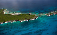 An aerial view of a narrow channel dividing Greater and Lesser Swan Islands, a chain of islands located 90 miles off the coast of Honduras.