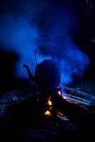 Tea boiling inside a traditional house, Abachkou, High Atlas, Morocco, 2002