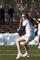 Boston College attacker Kate Rich (14) shoots from free position..Boston College (white) defeated Boston University (red), 12-9, on the Newton Campus Lacrosse Field at Boston College, on March 20, 2013.